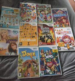 Bundle of Wii games and guitar hero