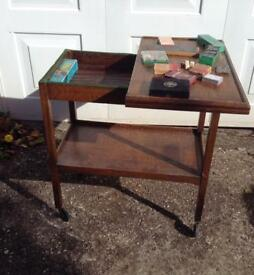 1930's SOLID OAK SWIVEL TOP CARD GAMES TABLE ON WHEELS WITH ORIGINAL GAMES.