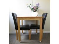 2 dining chairs and table, wooden kitchen table faux leather chairs DELIVERY AVAILABLE WITHIN LE3