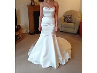Stunning size 8 satin fit & flare wedding dress never been worn or altered