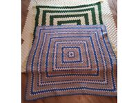 Two beautiful crocheted blankets.