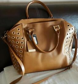 Brand new Handbags. (Still tags on them)