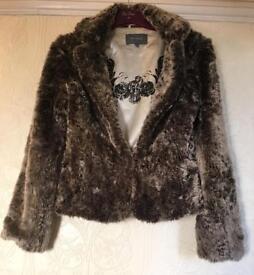 Faux fur jacket size 10