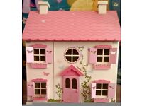 Adorable wooden doll house