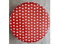 A set of three red polka dot metal boxes for kitchen storage