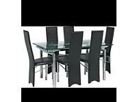 Extendable glass dining table with 6 chairs