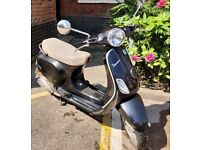 Vespa lx 125 2009, female rider [with free helmet] For sale
