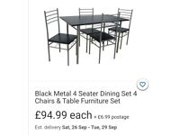 Black dining table set with 4 chairs - new