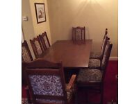 For sale OLD CHARM dining table and 8 chairs, including 1 Large carver and 1 standard carver