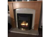 Wooden fireplace with electric fire