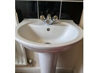 Twyfords pedestal sink, including gold and silver taps and waste.