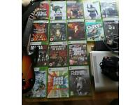Xbox 360 + 17 games + 2 controllers + guitar