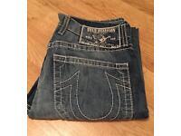 Brand new authentic men's waist 33 True Religion jeans. Mickey Big T style.