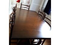 Solid dark oak extendable dining table and 6 chairs