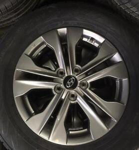 OEM Hyundai Santa Fe wheels installed All Weather Nokian Nordman 235/65R17 BRAND NEW