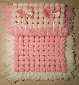 Hand knitted large pom Pom blanket