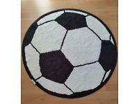 Circular football pattern floor rug, 3' diameter