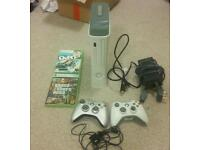 Xbox 360 console with 2 controllers.