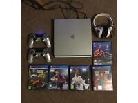 PS4 500GB console boxed with games