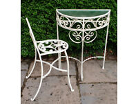Wrought-iron half moon table and chair