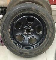 Set of 4 GoodYear Ultra Grip/Ice tires on rims