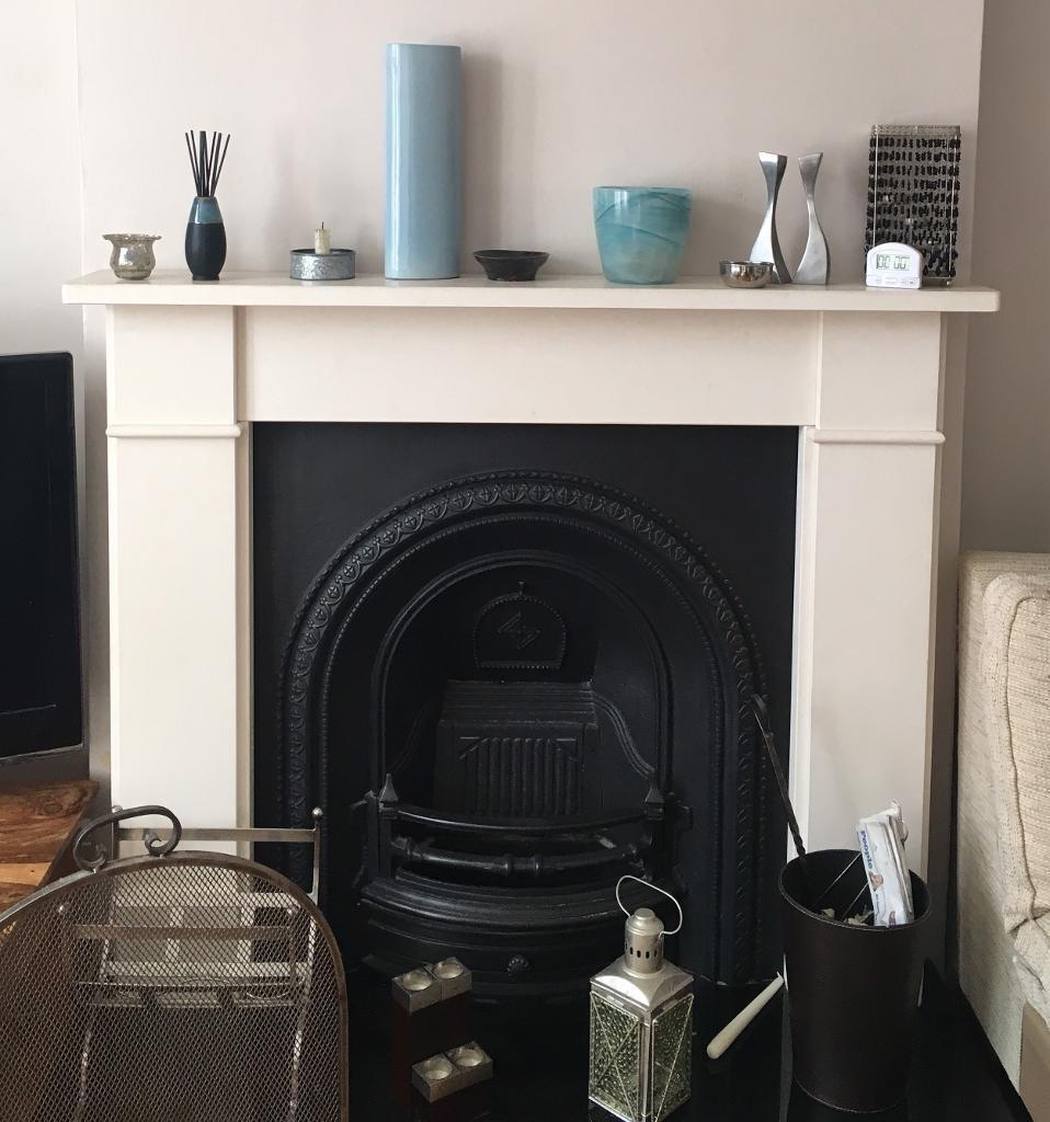 Fireplace; Brompton Limestone mantelpiece, cast iron back and black granite hearth