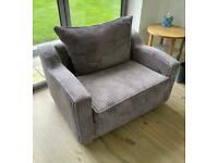Large comfy armchair with built in single bed