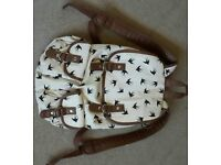 cheerful summery back pack, no wear, 2 outer magnetic button pockets, 1 inner zip pocket