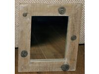 Mirror with rustic wood frame with metal protruding swirls