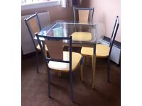 Glass & wood dining table & chairs