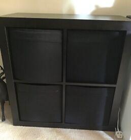 Dark brown storage cube.