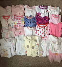 Bundle of newborn/ first size sleepsuits