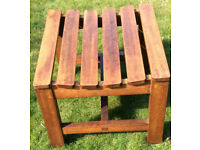 Two teak wooden garden stools. Outdoor wood chair