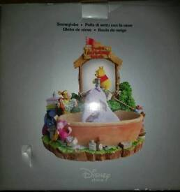 RARE DISNEY SNOWGLOBE WITH MUSICAL WIND UP AND WATER PUMP.