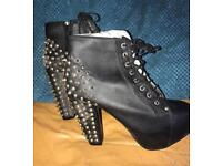 Black spiked boots