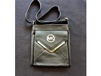 Woman's Michael Kors designer bag.