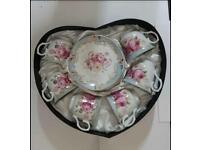 A Floral Print 12 Piece Tea Set of Cups/Saucers