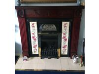 Victorian style tile fireplace surround with living flame gas fire