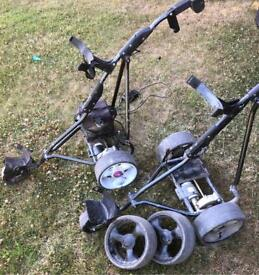 2 electric golf carts trolleys 1 good battery charger leads & 2 spare wheels spares repairs