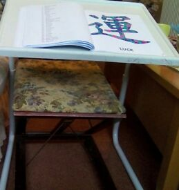 New fully adjustable mini table. Useful for crafts, reading, meals etc. Can be tucked under chair.