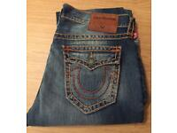 Brand new with tags authentic men's True Religion jeans. Ricky style. Waist 36. Thick stitch.