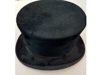 A victorian silk top hat with matching leather hat box