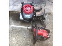 Petrol lawn mower chainsaw