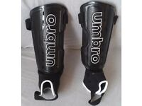 Brand new Umbro Black shin pads Large