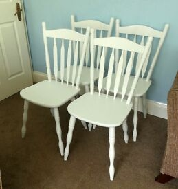 Four White Sturdy Wooden Chairs