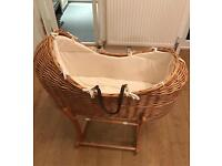 Wicker Moses Basket and rocking stand.