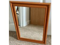 Wooden frame wall mirror.