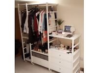 Big open wardrobe from Ikea. Customizable and lots of storage.
