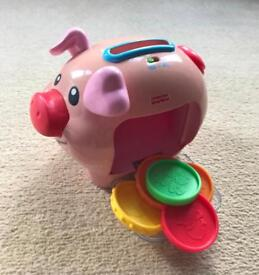 Toys Piggy bank,Laugh and learn cookie shape, Butterfly with shapes, iPad , 2 books , 1 bath book.