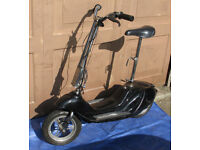 Folding Electric seated scooter 'Bretta V8' .. spares / repair £45 ono